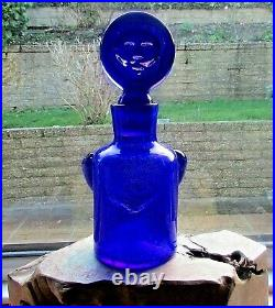 A bottle designed by Erik Hoglund for Kosta Boda with original Boda label