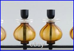 Erik Höglund for Kosta Boda. Candlestick in cast iron and mouth blown art glass